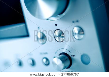 Steel Brushed Aluminum Front Panel With Multiple Buttons And Knobs Of A Digital Amplifier Radio Cd P