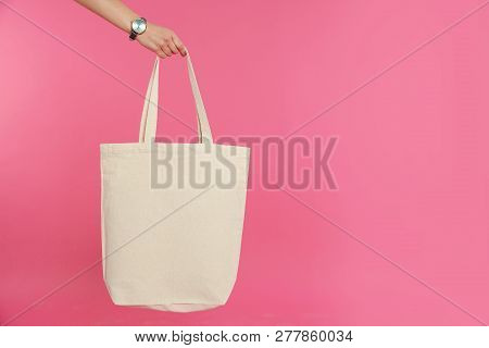 Woman Holding Eco Bag On Color Background. Mock Up For Design