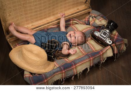 Waiting For A Baby. Sweet Little Baby. New Life And Birth. Small Girl In Suitcase. Traveling And Adv