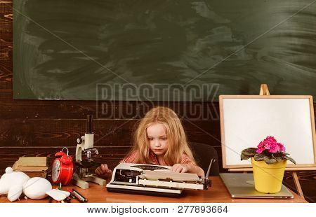 Little Girl Typewrite On Vintage Typewriter In School. Child Typewrite Keys On Vintage Machine In Cl