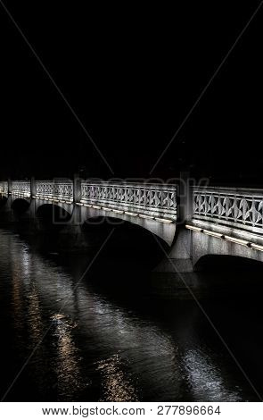Old Stone Bridge Over The River Limmat In Zurich At Night