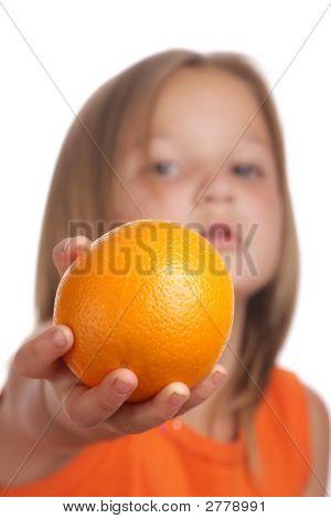 Child holding orange fruit (focus only on fruit) poster