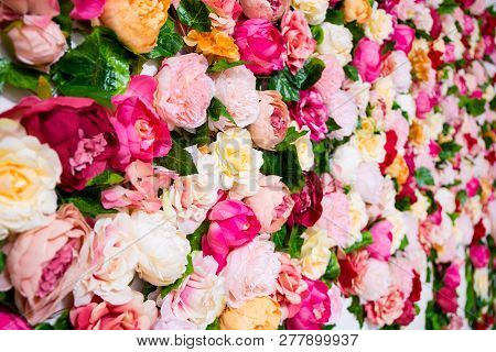 Wedding Decoration - Close Up Of Colorful Roses And Peonies Flowers On The Wall