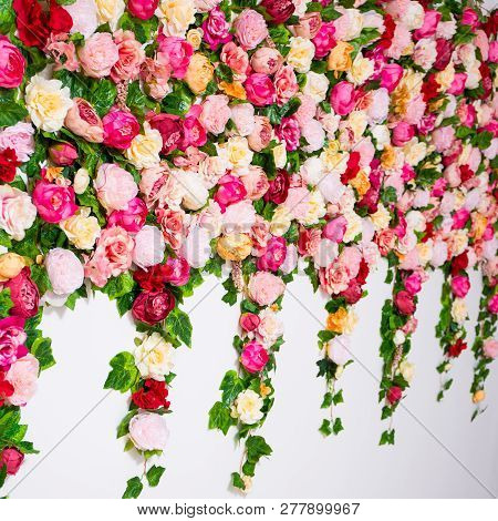 Spring And Summer Concept - Close Up Of Wall Background With Colorful Artificial Flowers