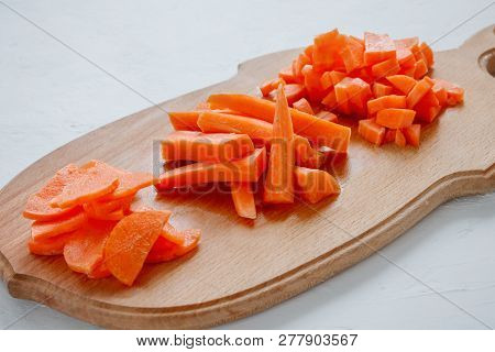 Healthy food - variants of slicing carrots on a wooden board poster