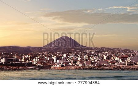 The City Of Heraklion With A View Of Mount Juktas Knows As Sleeping Zeus Mountain At Dawn, Crete, Gr