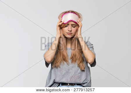 Close Up Studio Portrait Of Young Sleepy Woman In Grey T-shirt Feels Tired After Working, Feeling Te