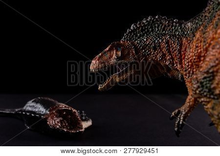Acrocanthosaurus In Front Of A Dinosaur Body On Dark Background
