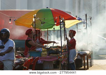 Leon, Leon, Nicaragua - March 10, 2018: Nicaraguan Women Cooking On The Street Typical Food
