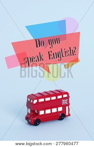 a red double-decker bus, typical of London, United Kingdom, and the question do you speak English? on a blue background
