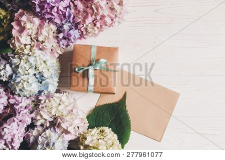 Beautiful Hydrangea Flowers, Gift Box And Paper Greeting Card On Rustic White Wood, Flat Lay With Sp