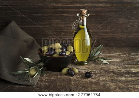 Bottle Of Extra Virgin Healthy Olive Oil With Fresh Olives Close Up