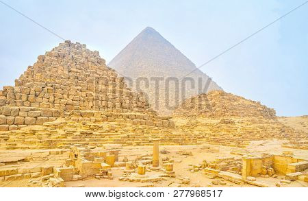 The Beautiful View On The Remains Of Small Pyramids Of The Queens And The Huge Pyramid Of Khufu On T