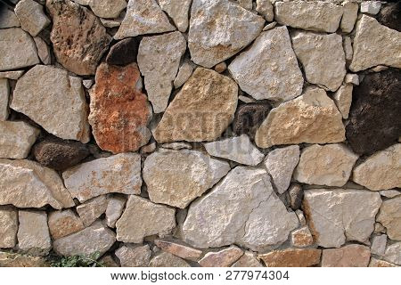 Many Stones In Wall As Natural Background