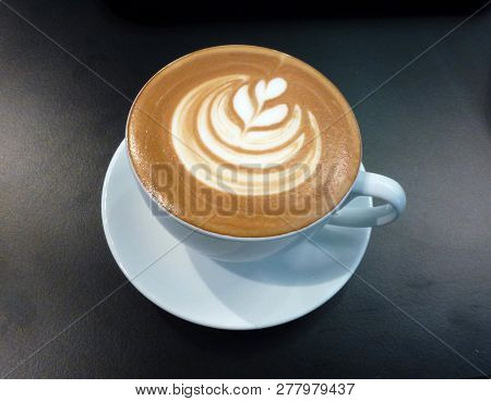The Cup With Coffee Latte On The Dark Background