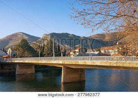 Bridge Across River. View Of Ivo Andric Bridge Across Trebisnjica River In Trebinje City On Sunny Wi