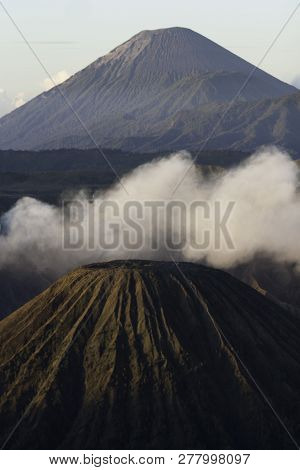 Smoky, Vulcanic Landscape At Morning Time About The Famous Indonesian Volcano, Bromo.
