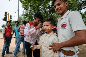 New Delhi, Aug 15, 2018 - A Boy Gets The Indian Flag Colors Painted On His Face On The Occasion Of T