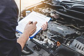 Services Car Engine Machine Concept, Automobile Mechanic Repairman Checking A Car Engine With Inspec