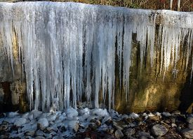 Icicles On The Wall As Natural Background