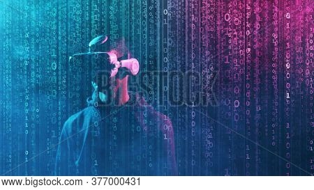 Portrait of a man in virtual reality helmet over abstract digital background. Obscured dark face in VR goggles. Internet, darknet, gaming and cyber simulation.