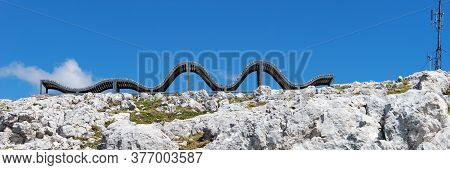 Abstract Wooden Chaise Longue In Mountains Dachstein Krippenstein In Austria. Panoramic Image