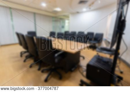 Blurry Abstract Background Of Empty Modern Boardroom, Meeting Office Room