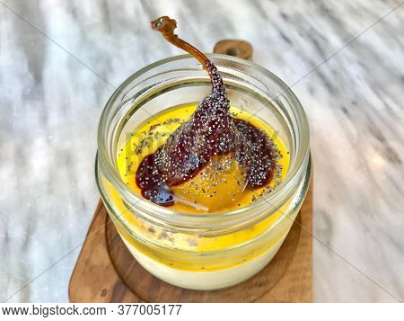 Turkish Style Custard Pudding Dessert With Safflower, Pear, Salep / Sahlep And Poppy Seeds In Jar.