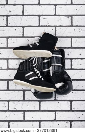 Against A Brick Wall Black Gloves And Shoes For Training