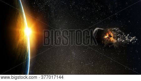 Asteroid Flies Near The Earth Orbit. Meteorite Approaching Earth.  Elements Of This Image Furnished