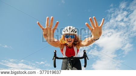 Vigorous Young Ginger Woman Riding On A Professional Bike Hands Free