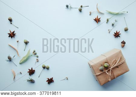 Autumn Creative Holiday Present. Handmade Paper Gift Box With Foliage Dried Leaves, Pine Cones And A