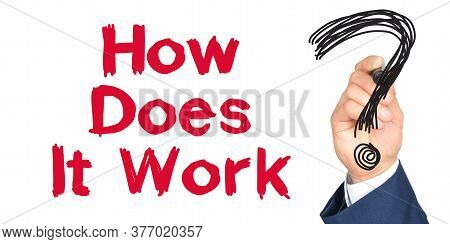 Hand With Marker Writing: How Does It Work. Hand Of A Businessman With A Marker.