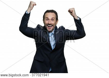 Portrait Of Businessman Gesturing Fists Up. Overjoyed Mature Man In Formal Clothes Isolated On White