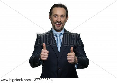 Cheerful Man In Suit With Thumbs Up. Well-dressed Mature Businessman Isolated On White Background.