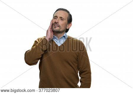 Sick Mature Man With Toothache. Caucasian Adult Man Is Sufferingand Feeling Pain. Casual-dressed Man