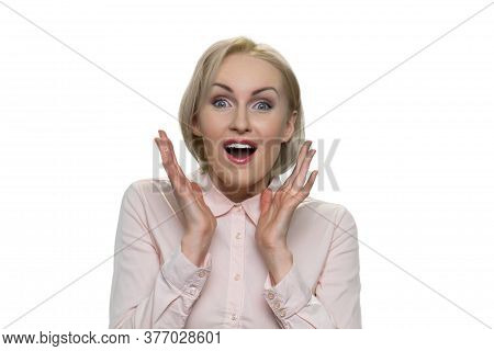 Portrait Of Surprised Caucasian Middle-aged Business Lady. Shocked Blond Woman Wearing Formal Shirt.