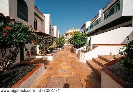 Elevaterd View Of Apartments And Townhouses In The Town Centre, Spanish Town House Middle-class Hous