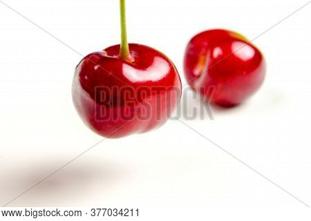 Closeup Of Red Cherries On White Background Isolated