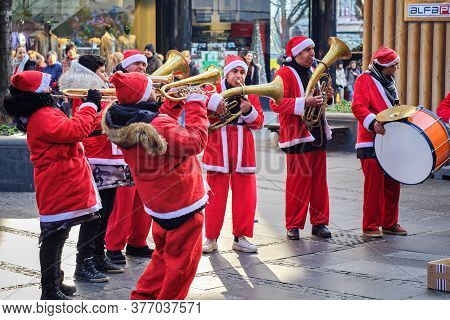 Belgrade / Serbia - January 1, 2020: Brass Trumpet Band Musicians Dressed In Santa Claus Costumes Pe