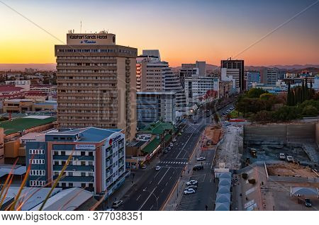 Windhoek, Namibia - August 4, 2013: View Of The City Center At Sunset. Windhoek Is The Capital And L