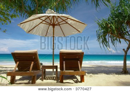 Two Chairs And Umbrella