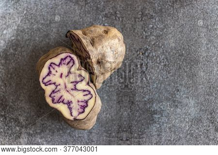 View Of Colored Native Peruvian Potato On Gray Background