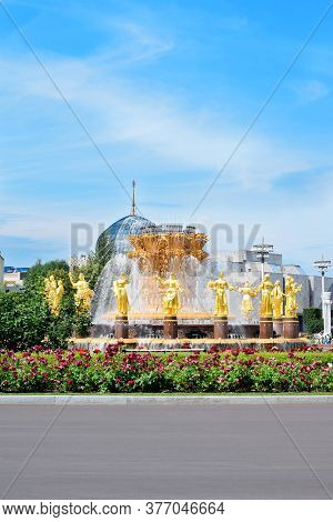 Moscow, Russia - July 2, 2020: Peoples Friendship Fountain In Vdnkh Park Against The Blue Sky