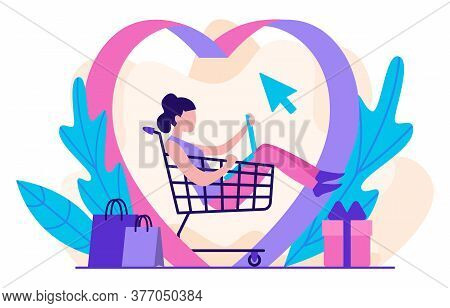 Love For Online Shopping Concept. A Girl Sits In A Shopping Cart And Looks At Her Laptop, Making Pur