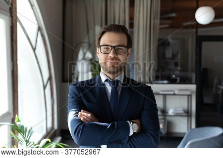 Profile Picture Of Confident Businessman Posing At Workplace