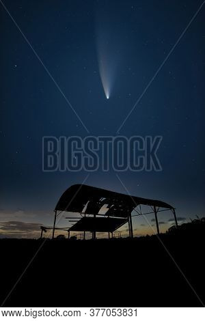 Digital Composite Image Of Neowise Comet Over Beautiful Landscape Image Of Old Derelict Barn Silhoue