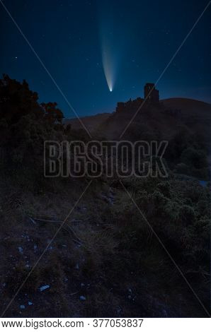 Digital Composite Image Of Neowise Comet Over Beautiful Dreamy Fairytale Castle Ruins