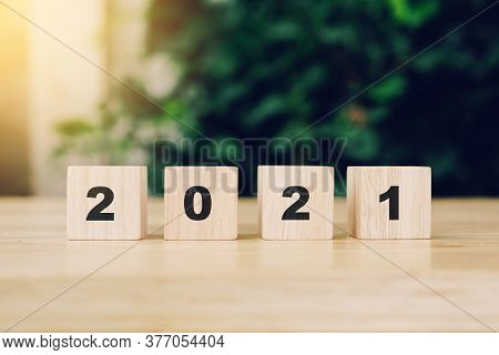 2021 Happy New Year On Wood Block On Wood Table With Sunlight. New Year Concept.