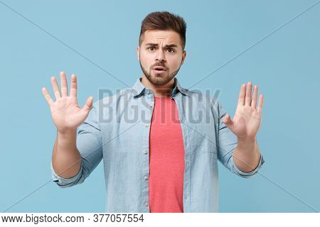 Shocked Perplexed Young Bearded Guy In Casual Shirt Posing Isolated On Pastel Blue Background Studio
